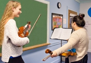 Dr. Leah Zelnick, violin, teaches a middle school student at the School's W. Boylston satellite.