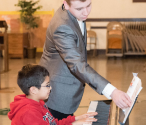 Afternoon Tunes student takes piano lessons